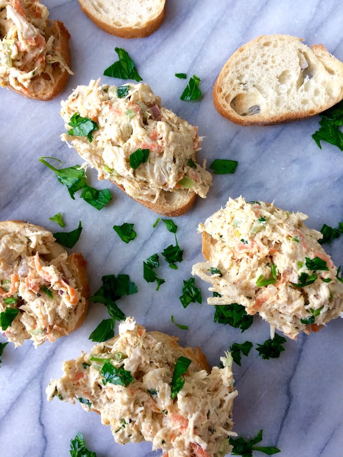 Spoonfuls of curry chicken salad, loaded with goodies, atop toasted slices of baguette.