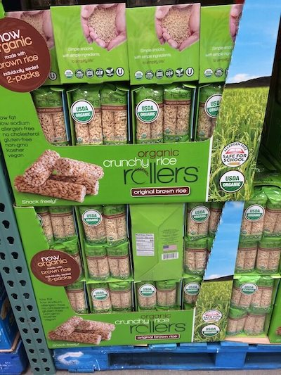 Costco shelf filled with Organic Crunchy Rice Rollers, a nut free Costco snack.