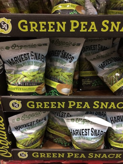 Bags of Harvest Snaps Green Pea Snap Crisps at Costco.