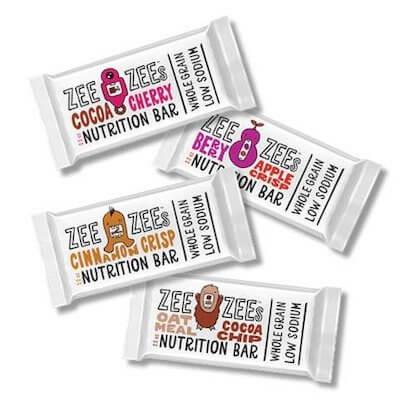 Four scattered Zee Zee's nut free nutrition bars.