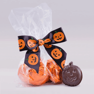A gift bag of jack o lantern shaped chocolates from Amanda's Own.